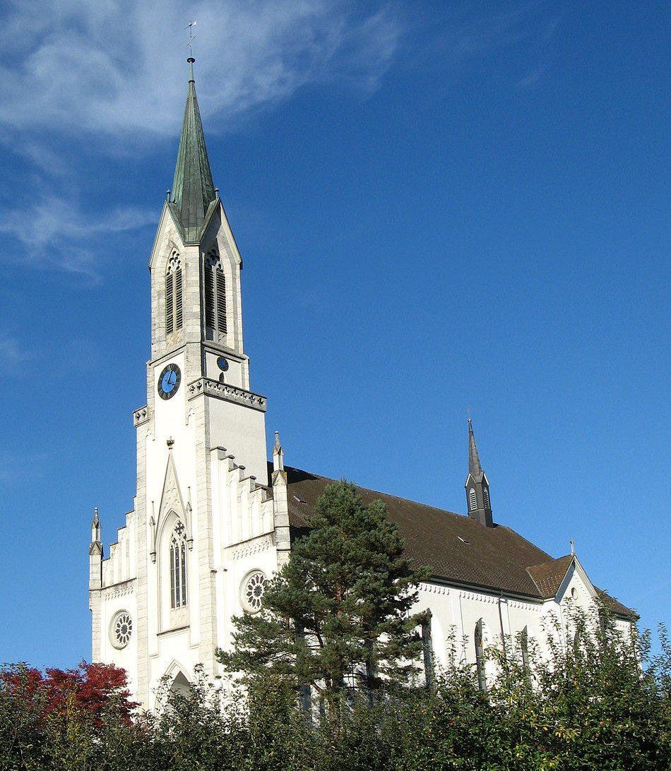"""Pfarrkirche St. Georg in Bünzen, Ansicht von Süden. (Urheber: Voyager / Wiki / Lizenz: <a href=""""https://creativecommons.org/licenses/by-sa/3.0/deed.en"""" target=""""_blank"""">CC</a>)"""