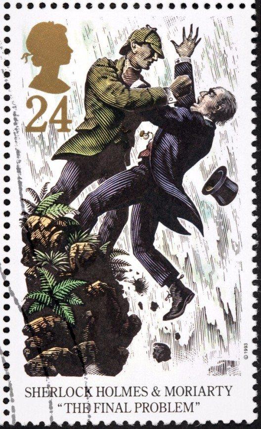 Eine Briefmarke mit Sherlock Holmes und dem Professor Moriarty. (Bild: © Sergey Goryachev - shutterstock.com)